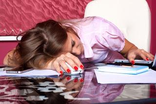Tired-girl-resting-on-desk.jpg